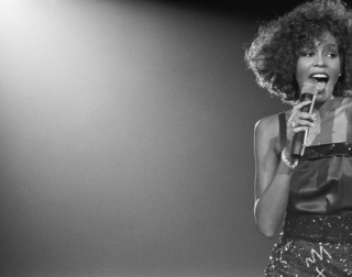 Singer Whitney Houston singing on stage