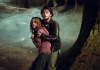 Actor Daniel Radcliffe holding actress Emma Watson in a forest
