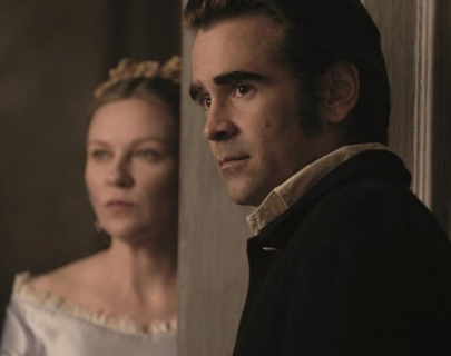 Actors Kirsten Dunst and Colin Farrell dressed in period costume