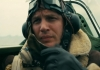Actor Tom Hardy in a World War 2 place putting an air pressure mask on