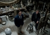 Actors Armie Hammer and Geoffry Rush look up to the camera whilst in an artist's studio
