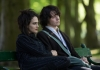 Actors Jessica Brown Findlay and Jack Lowden sitting on a bench