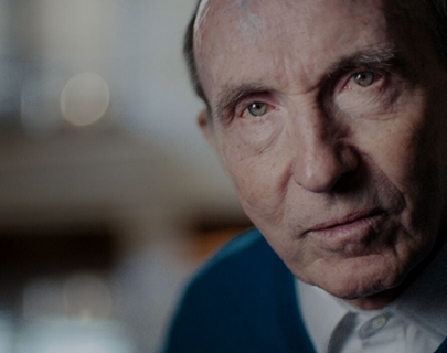 Sir Frank Williams looking into the camera