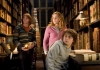 Actors Daniel Radcliffe, Emma Watson and Rupert Grint in the Hogwarts Library