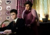 Actor Imelda Staunton watches actor Daniel Radcliffe writing lines