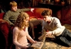 Actors Daniel Radcliffe, Rupert Grint and Emma Watson reading in the Gryffindor common room