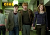 Actors Daniel Radcliffe, Rupert Grint and Emma Watson in muggle clothes walking in the street