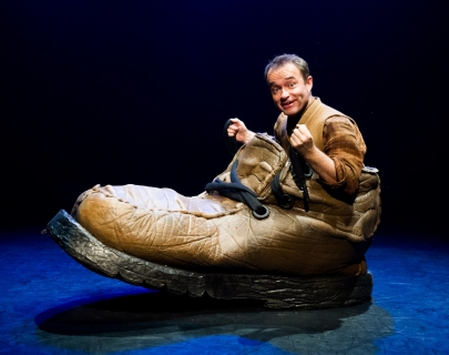 Actor Patrick Lynch, playing Jack, sitting in a giant shoe and smiling at the camera