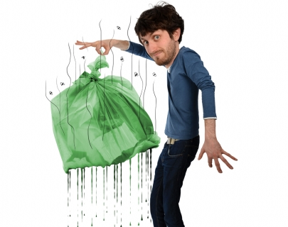 Cartoon depiction of Jay Foreman dropping a green rubbish bag