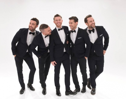 The Overtones - dressed in dinner suits and bow ties standing on a white background