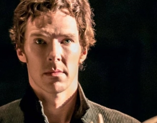 Actor Benedict Cumberbatch dressed as Hamlet looking directly at the camera