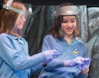 Two girls with gloves and protective masks