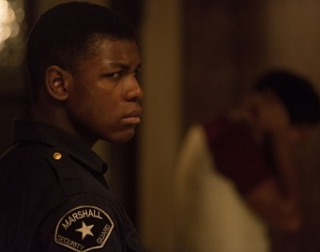 Actor John Boyega as security guard Melvin in Detroit.