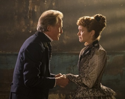 Inspector Kildare (Bill Nighy) holds the hands of a distressed Elizabeth Cree (Olivia Cooke) in 1880s London.