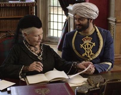 Queen Victoria (Judi Dench) and Abdul Karim (Ali Fazal) look through papers in 1887.