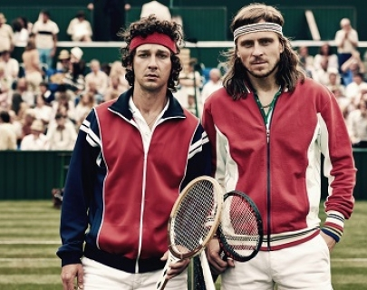 McEnroe (LaBeouf) and Bjorn Borg (Gudnason) stand on a tennis court, ready to play.