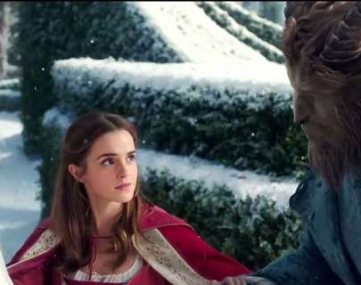 A young woman in a red cloak stands in the snow with a Prince enchanted as a Beast.