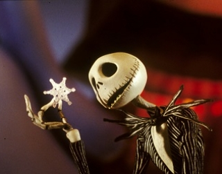 Animation. Pumpkin King, Jack Skellington, marvels at a snow flake in Christmastown.
