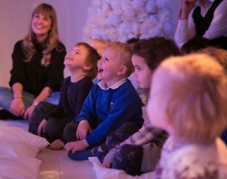 Children laughing while watching a show