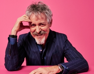 Griff Rhys Jones on a pink background