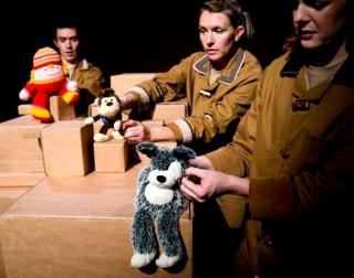 Three actors holding stuffed toys