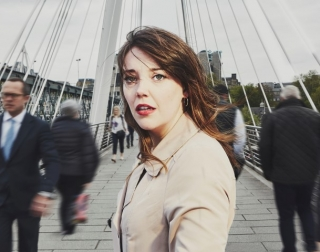 Actress Maddie Rice standing on a bridge in London
