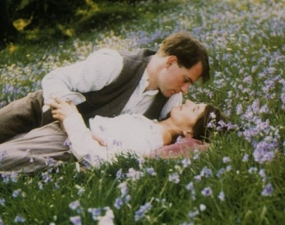 Two people in an embrace in a meadow