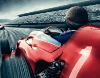 A driver speeding in a red race-car
