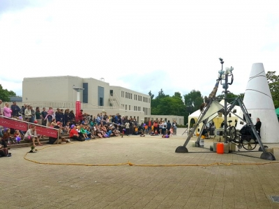 Crowd outside Warwick Arts Centre watching actors perform
