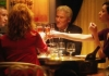 Actors Steve Coogan, Laura Linney, Richard Gere and Rebecca Hall sitting at a table making a toast with champagne glasses