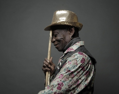 Tony Allen holding drum sticks