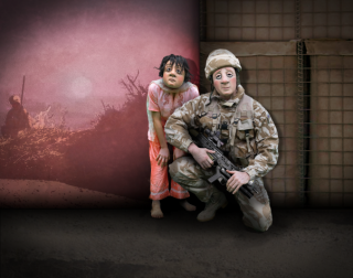 Two actors wearing masks, one dressed as a young girl one as a soldier