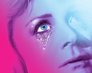 Close up of a woman crying glittery tears