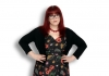 Comedian Angela Barnes against a white background