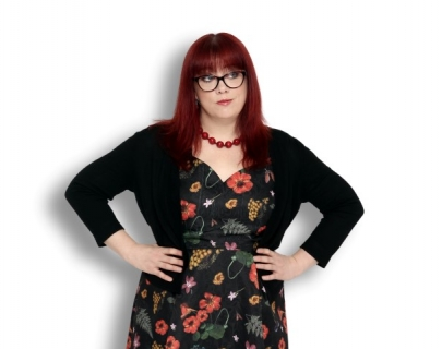 Comedian Angela Barnes against a white background