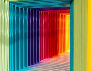 Image shows a rainbow coloured walkway