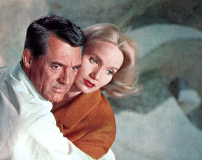 Cary Grant holding Eva Marie Saint in his arms