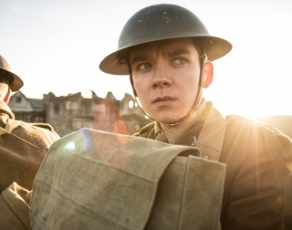 Actor dressed in World War 1 clothing and a tin helmet