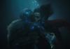 Two people underwater, kissing