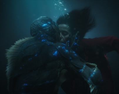 Two people underwater, kissing