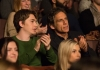 Actors Ben Stiller and Austin Abrams sitting in an audience and clapping