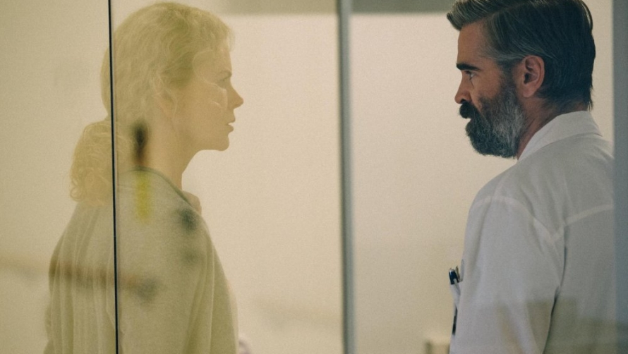 Nicole Kidman and Colin Farrell staring at each other through a glass window