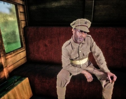 A soldier sitting on a train bench