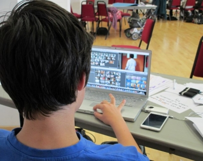 Kid editing footage on a computer
