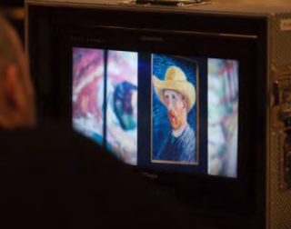 A small screen showing one of Van Gogh's self portraits