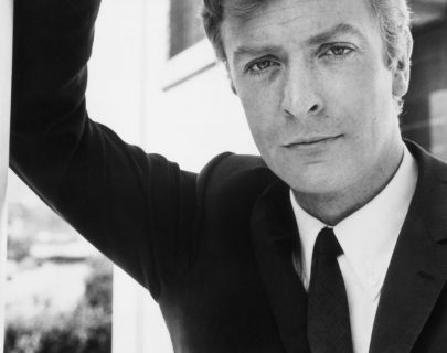 A black and white image of young Michael Caine