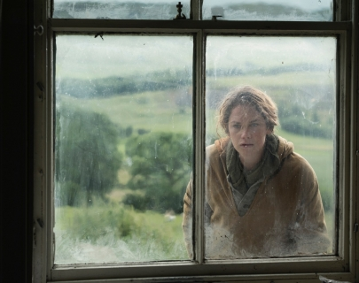 Actress Ruth Wilson looking into a window