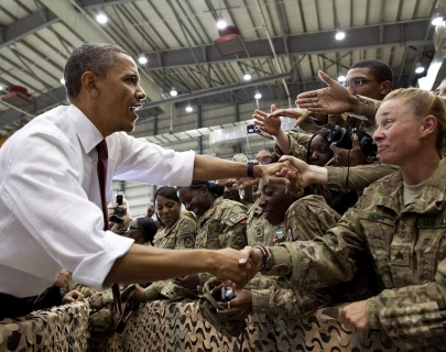 An image of Barack Obama meeting excited U.S. troops
