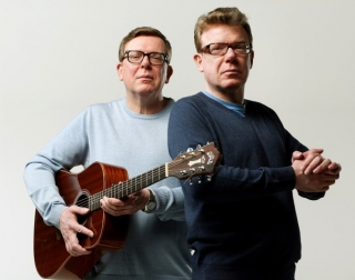 The musical duo against a white background