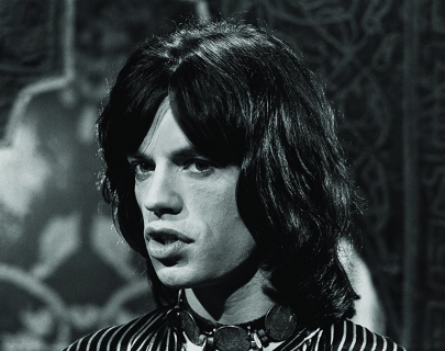 Medium shot of Mick Jagger looking off camera in black and white